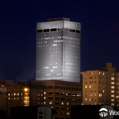 WoodmenLife Tower glowing white